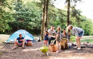 A family camping in the woods near a lake
