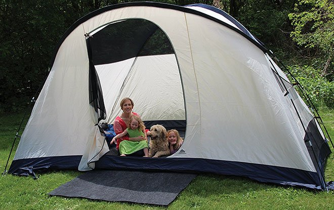 Family camping hack using rugs in and out of the tent.