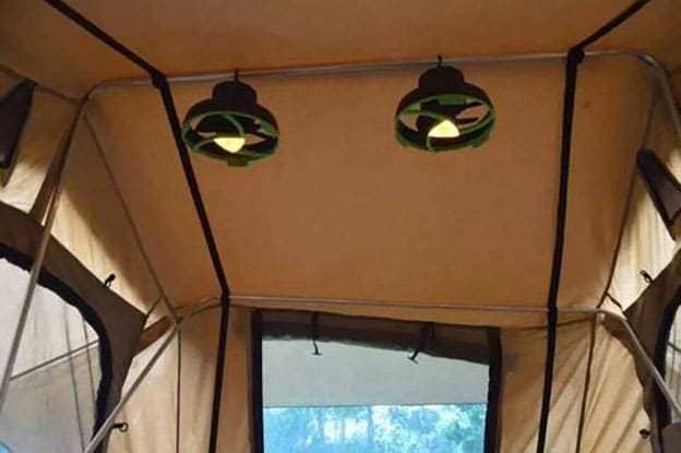 Fans hanging in a family camping tent.