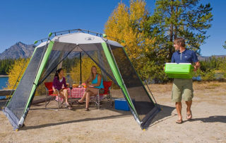 A screened in camping canopy.