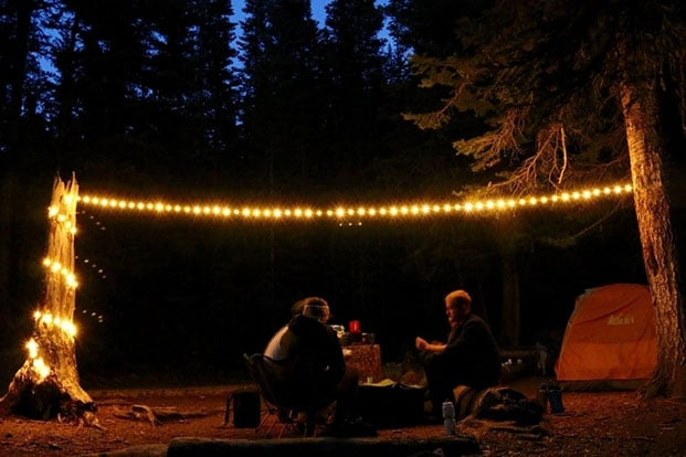 Using string lights while family camping.