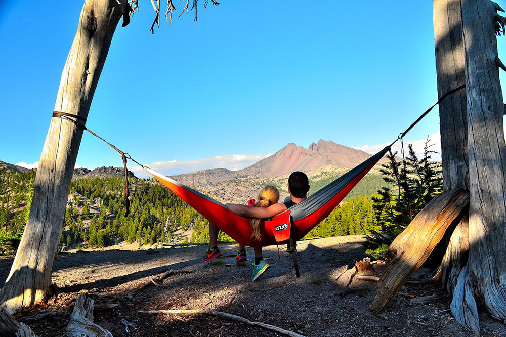 Eagles Nest Outfitters double nest hammock in the forest.