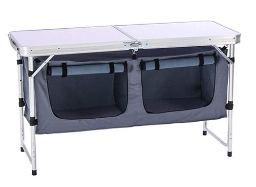 Folding camp kitchen table with storage compartments.