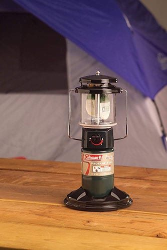 Coleman Quickpack Propane Lantern in use near a tent.