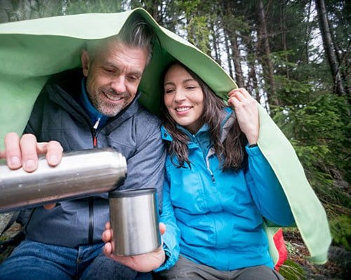 Couple camping in the rain.