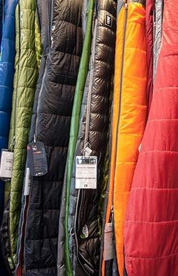 Choosing between different types of sleeping bags.