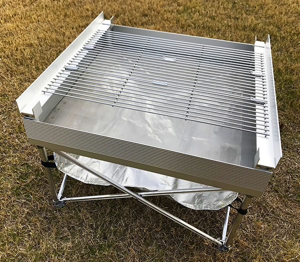Portable fire pit with grill attachement